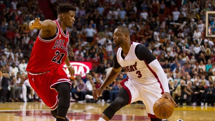 Apr 7, 2016; Miami, FL, USA; Miami Heat guard Dwyane Wade (3) dribbles the ball as Chicago Bulls guard Jimmy Butler (21) defends during the second half at American Airlines Arena. Mandatory Credit: Steve Mitchell-USA TODAY Sports