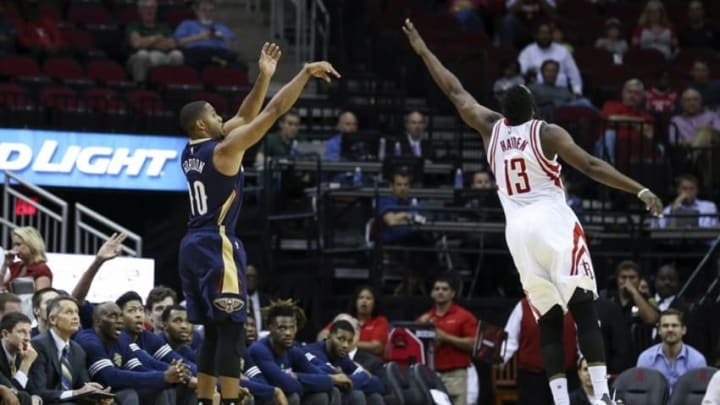 Oct 19, 2015; Houston, TX, USA; New Orleans Pelicans guard Eric Gordon (10) shoots during the first quarter as Houston Rockets guard James Harden (13) defends at Toyota Center. Mandatory Credit: Troy Taormina-USA TODAY Sports