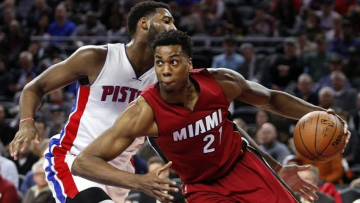 Apr 12, 2016; Auburn Hills, MI, USA; Miami Heat center Hassan Whiteside (21) is defended by Detroit Pistons center Andre Drummond (0) during the first quarter at The Palace of Auburn Hills. Mandatory Credit: Raj Mehta-USA TODAY Sports