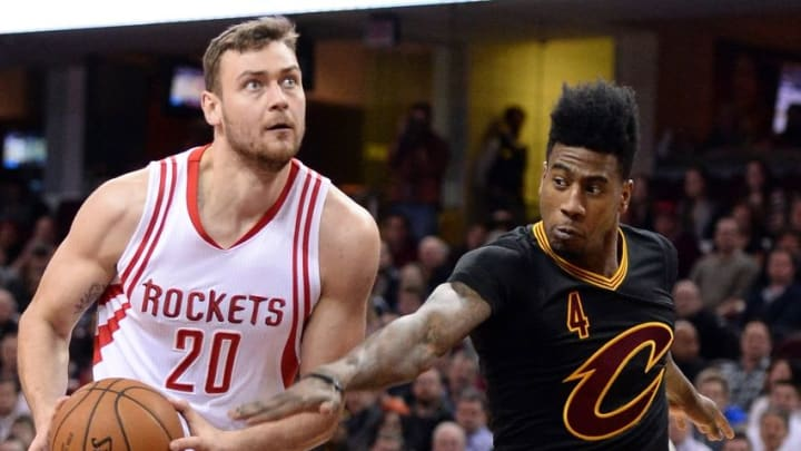 Mar 29, 2016; Cleveland, OH, USA; Houston Rockets forward Donatas Motiejunas (20) drives and Cleveland Cavaliers guard Iman Shumpert (4) defends during the first quarter at Quicken Loans Arena. Mandatory Credit: Ken Blaze-USA TODAY Sports