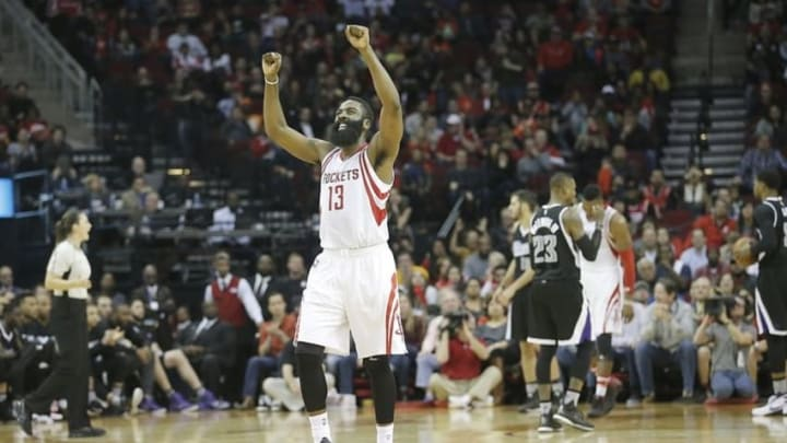 Dec 5, 2015; Houston, TX, USA; Houston Rockets guard James Harden (13) reacts after the Rocker scored against the Sacramento Kings in the second half at Toyota Center. Rockets won 120-111. Mandatory Credit: Thomas B. Shea-USA TODAY Sports