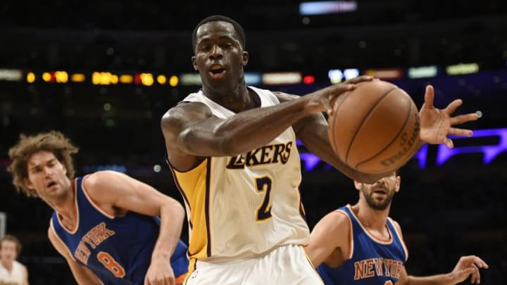 Mar 13, 2016; Los Angeles, CA, USA; Los Angeles Lakers forward Brandon Bass (2) grabs the loose ball in front of New York Knicks center Robin Lopez (left) and guard Jose Calderon (right) during the fourth quarter at Staples Center. The New York Knicks won 90-87. Mandatory Credit: Kelvin Kuo-USA TODAY Sports