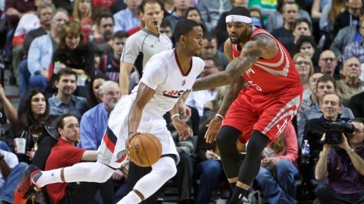 Feb 10, 2016; Portland, OR, USA; Portland Trail Blazers forward Maurice Harkless (4) dribbles past Houston Rockets center Josh Smith (5) during the first quarter at the Moda Center. Mandatory Credit: Craig Mitchelldyer-USA TODAY Sports