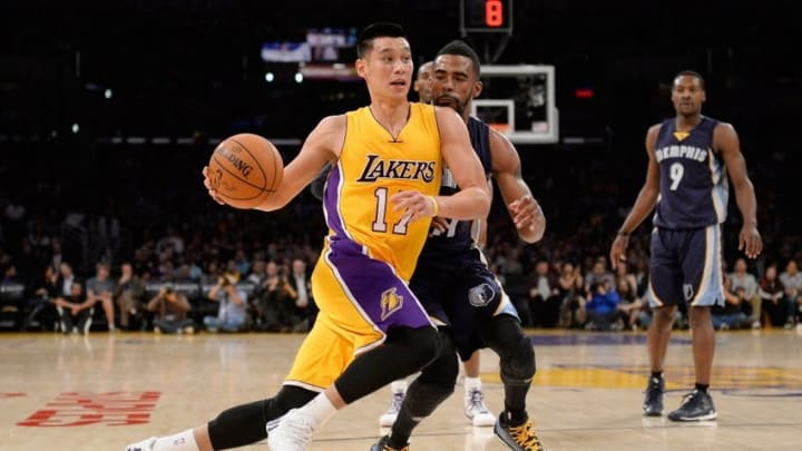 Nov 26, 2014; Los Angeles, CA, USA; Los Angeles Lakers guard Jeremy Lin (17) drives to the basket as Memphis Grizzlies guard Mike Conley (11) defends during the first half at Staples Center. Mandatory Credit: Richard Mackson-USA TODAY Sports