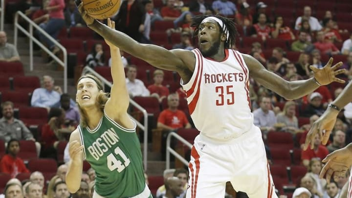 Nov 16, 2015; Houston, TX, USA; Boston Celtics center Kelly Olynyk (41) and Houston Rockets forward Montrezl Harrell (35) reach for a loose ball in the first quarter at Toyota Center. Mandatory Credit: Thomas B. Shea-USA TODAY Sports
