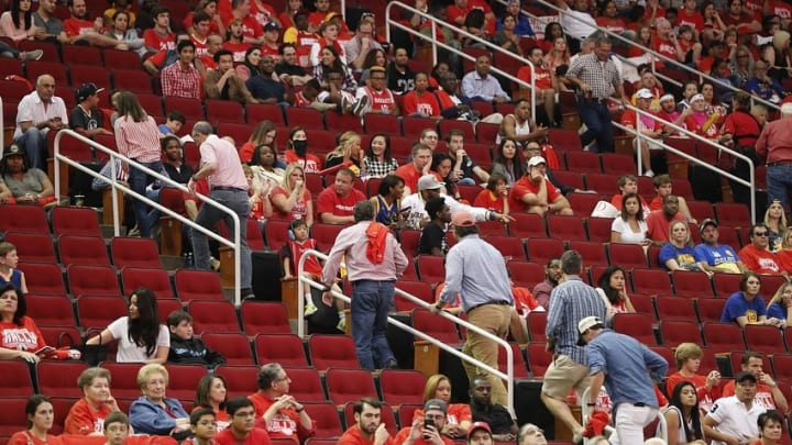 Apr 24, 2016; Houston, TX, USA; Fans leave in the middle of the fourth quarter while the Houston Rockets play the Golden State Warriors in game four of the first round of the NBA Playoffs at Toyota Center. Golden State Warriors won 121 to 94. Mandatory Credit: Thomas B. Shea-USA TODAY Sports