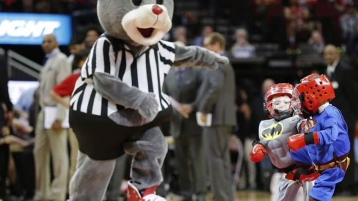 """Mar 25, 2016; Houston, TX, USA; Boys dressed as Superman and Batman spar each as Houston Rockets mascot """"Clutch"""" referees during a timeout during the Houston Rockets and Toronto Raptors basketball game at Toyota Center. Mandatory Credit: Thomas B. Shea-USA TODAY Sports"""