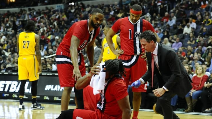 Mar 5, 2016; Washington, DC, USA; Washington Wizards center Nene Hilario (42) is tended to by a team trainer after suffering an injury against the Indiana Pacers during the first half at Verizon Center. Mandatory Credit: Brad Mills-USA TODAY Sports