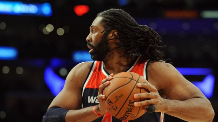 March 27, 2016; Los Angeles, CA, USA; Washington Wizards center Nene Hilario (42) controls the ball against Los Angeles Lakers during the first half at Staples Center. Mandatory Credit: Gary A. Vasquez-USA TODAY Sports
