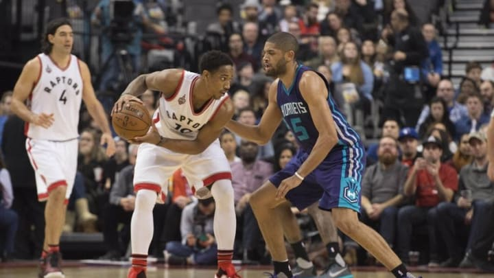 Jan 1, 2016; Toronto, Ontario, CAN; Toronto Raptors guard DeMar DeRozan (10) controls the ball as Charlotte Hornets guard Nicolas Batum (5) tries to defend during the second quarter in a game at Air Canada Centre. Mandatory Credit: Nick Turchiaro-USA TODAY Sports