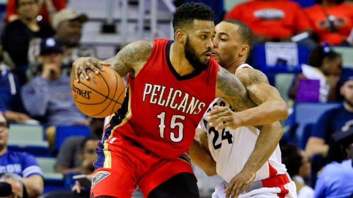 Mar 26, 2016; New Orleans, LA, USA; New Orleans Pelicans forward Alonzo Gee (15) handles the ball while defended by Toronto Raptors guard Norman Powell (24) during the second quarter of a game at the Smoothie King Center. Mandatory Credit: Derick E. Hingle-USA TODAY Sports