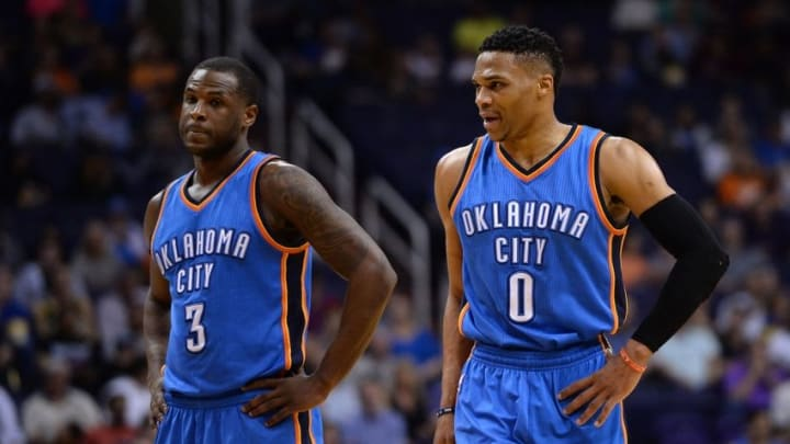 Feb 8, 2016; Phoenix, AZ, USA; Oklahoma City Thunder guard Russell Westbrook (0) talks with guard Dion Waiters (3) during the first half against the Phoenix Suns at Talking Stick Resort Arena. Mandatory Credit: Jennifer Stewart-USA TODAY Sports