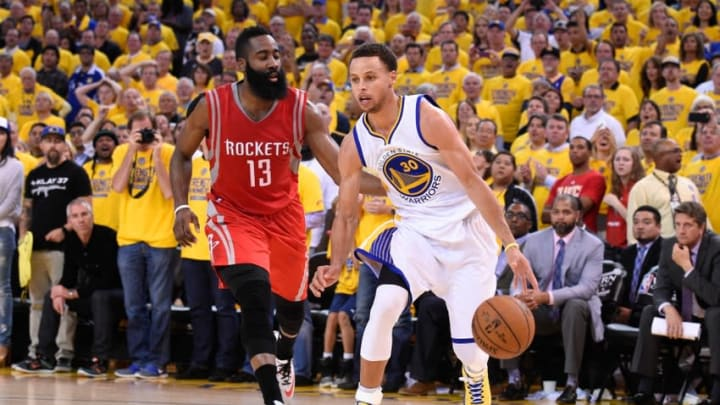 May 27, 2015; Oakland, CA, USA; Golden State Warriors guard Stephen Curry (30) dribbles the basketball against Houston Rockets guard James Harden (13) during the fourth quarter in game five of the Western Conference Finals of the NBA Playoffs at Oracle Arena. The Warriors defeated the Rockets 104-90 to advance to the NBA Finals. Mandatory Credit: Kyle Terada-USA TODAY Sports