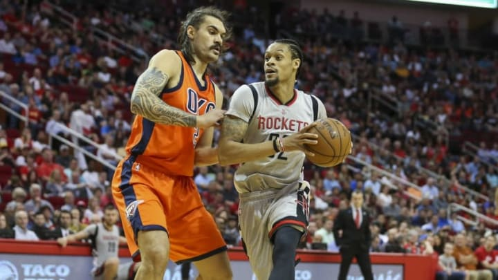 Apr 3, 2016; Houston, TX, USA; Houston Rockets guard K.J. McDaniels (32) dribbles the ball as Oklahoma City Thunder center Steven Adams (12) defends during the second quarter at Toyota Center. Mandatory Credit: Troy Taormina-USA TODAY Sports