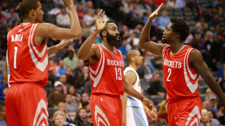 Dec 17, 2014; Denver, CO, USA; Houston Rockets guard James Harden (13) celebrates with guard Patrick Beverley (2) and forward Trevor Ariza (1) during the second half against the Denver Nuggets at Pepsi Center. The Rockets won 115-111 in overtime. Mandatory Credit: Chris Humphreys-USA TODAY Sports