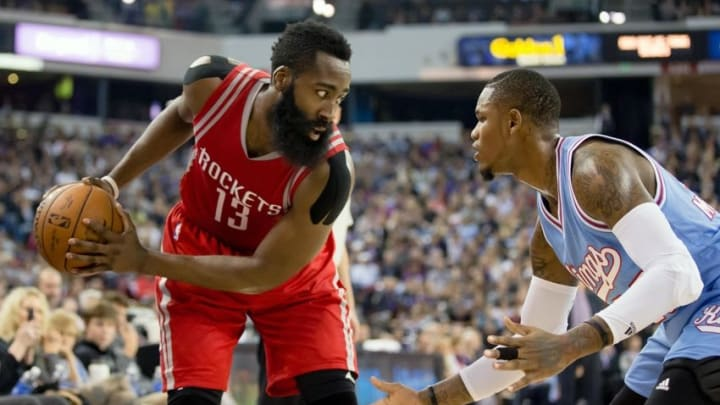 Nov 6, 2015; Sacramento, CA, USA; Houston Rockets guard James Harden (13) controls the ball against Sacramento Kings guard Ben McLemore (23) during the second quarter at Sleep Train Arena. Mandatory Credit: Kelley L Cox-USA TODAY Sports