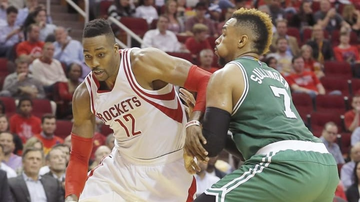 Nov 16, 2015; Houston, TX, USA; Houston Rockets center Dwight Howard (12) dribbles against Boston Celtics center Jared Sullinger (7) in the second half at Toyota Center. Celtics won 111 to 95. Mandatory Credit: Thomas B. Shea-USA TODAY Sports