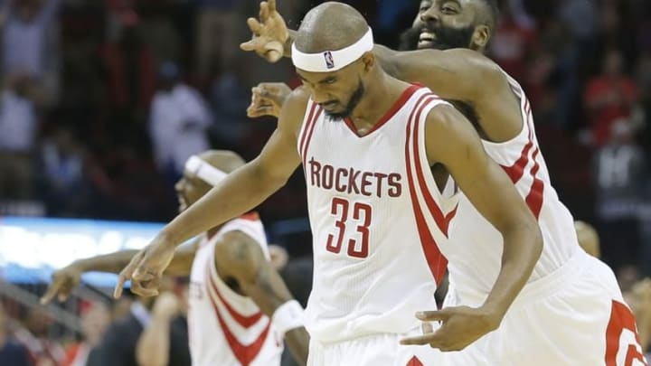 Nov 18, 2015; Houston, TX, USA; Houston Rockets guard Corey Brewer (33) and guard James Harden (13) react following a three point basket by Brewer to tie the game in regulation against the Portland Trail Blazers in the fourth quarter at Toyota Center. The Rockets won in overtime 108-103. Mandatory Credit: Thomas B. Shea-USA TODAY Sports