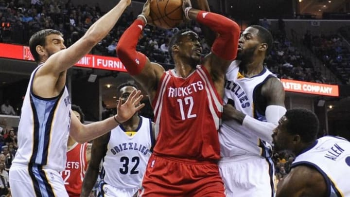 Nov 20, 2015; Memphis, TN, USA; Houston Rockets center Dwight Howard (12) handles the ball against Memphis Grizzlies forward JaMychal Green (0) and Memphis Grizzlies center Marc Gasol (33) during the second half at FedExForum. Memphis Grizzlies beat Houston Rockets 96-84. Mandatory Credit: Justin Ford-USA TODAY Sports