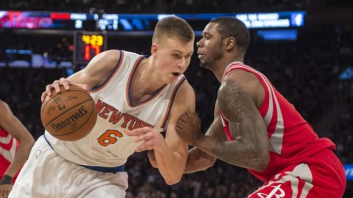 Nov 29, 2015; New York, NY, USA; New York Knicks power forward Kristaps Porzingis (6) drives the ball against Houston Rockets power forward Terrence Jones (6) during the third quarter of the game at Madison Square Garden. The Rockets won 116-111. Mandatory Credit: Gregory J. Fisher-USA TODAY Sports