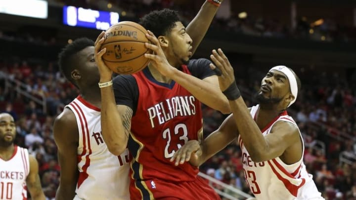 Dec 2, 2015; Houston, TX, USA; New Orleans Pelicans forward Anthony Davis (23) controls the ball as Houston Rockets center Clint Capela (15) and guard Corey Brewer (33) defend during the third quarter at Toyota Center. The Rockets defeated the Pelicans 108-101. Mandatory Credit: Troy Taormina-USA TODAY Sports