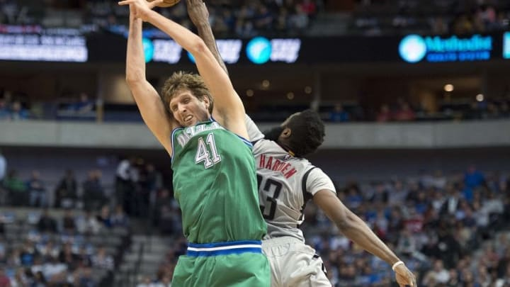 Dec 4, 2015; Dallas, TX, USA; Dallas Mavericks forward Dirk Nowitzki (41) and Houston Rockets guard James Harden (13) jump for the loose ball during the first quarter at the American Airlines Center. Mandatory Credit: Jerome Miron-USA TODAY Sports