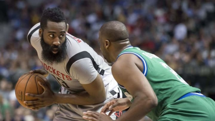 Dec 4, 2015; Dallas, TX, USA; Dallas Mavericks guard Raymond Felton (2) guards Houston Rockets guard James Harden (13) during the second half at the American Airlines Center. The Rockets defeat the Mavericks 100-96. Harden leads his team with 25 points. Mandatory Credit: Jerome Miron-USA TODAY Sports