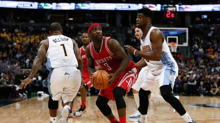 Nov 13, 2015; Denver, CO, USA; Denver Nuggets guard Emmanuel Mudiay (0) guards Houston Rockets guard Ty Lawson (3) in the fourth quarter at the Pepsi Center. Mandatory Credit: Isaiah J. Downing-USA TODAY Sports