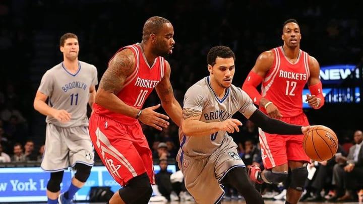 Dec 8, 2015; Brooklyn, NY, USA; Brooklyn Nets guard Shane Larkin (0) drives past Houston Rockets forward Marcus Thornton (10) during the third quarter at Barclays Center. Brooklyn Nets won 110-105. Mandatory Credit: Anthony Gruppuso-USA TODAY Sports
