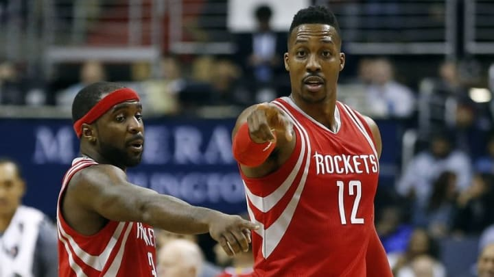 Dec 9, 2015; Washington, DC, USA; Houston Rockets center Dwight Howard (12) talks with Rockets guard Ty Lawson (3) against the Washington Wizards in the fourth quarter at Verizon Center. The Rockets won 109-103. Mandatory Credit: Geoff Burke-USA TODAY Sports