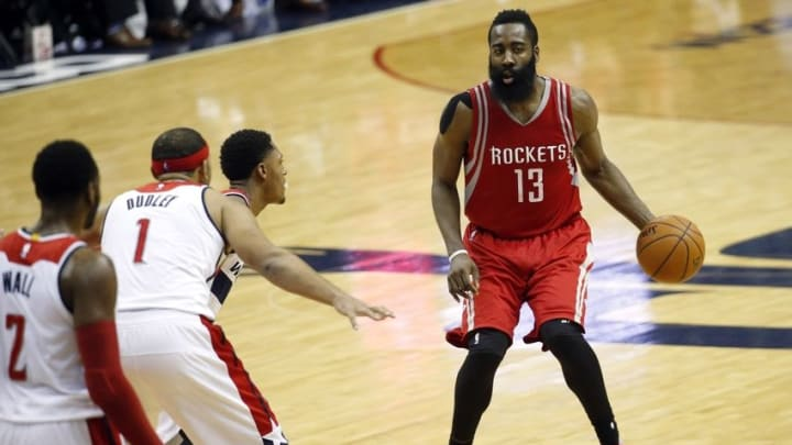 Dec 9, 2015; Washington, DC, USA; Houston Rockets guard James Harden (13) dribbles the ball as Washington Wizards guard Jared Dudley (1) and Wizards guard Bradley Beal (3) defend in the third quarter at Verizon Center. The Rockets won 109-103. Mandatory Credit: Geoff Burke-USA TODAY Sports