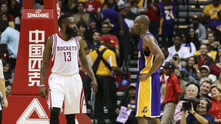 Dec 12, 2015; Houston, TX, USA; Houston Rockets guard James Harden (13) and Los Angeles Lakers forward Kobe Bryant (24) talk during the third quarter at Toyota Center. The Rockets defeated the Lakers 126-97. Mandatory Credit: Troy Taormina-USA TODAY Sports