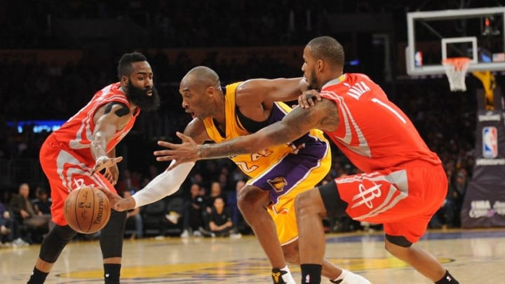 December 17, 2015; Los Angeles, CA, USA; Los Angeles Lakers forward Kobe Bryant (24) moves the ball against Houston Rockets guard James Harden (13) and forward Trevor Ariza (1) during the second half at Staples Center. Mandatory Credit: Gary A. Vasquez-USA TODAY Sports