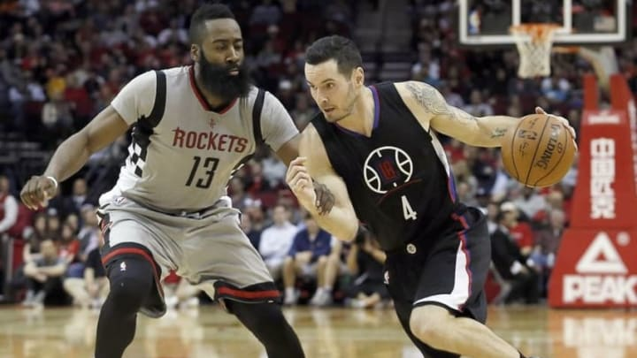 Dec 19, 2015; Houston, TX, USA; Los Angeles Clippers guard J.J. Redick (4) dribbles against Houston Rockets guard James Harden (13) in the second half at Toyota Center. Rockets won 107 to 97. Mandatory Credit: Thomas B. Shea-USA TODAY Sports