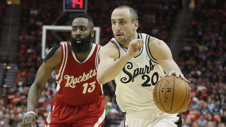 Dec 25, 2015; Houston, TX, USA; San Antonio Spurs guard Manu Ginobili (20) dribbles against the Houston Rockets guard James Harden (13) in the first half of a NBA basketball game on Christmas at Toyota Center. Mandatory Credit: Thomas B. Shea-USA TODAY Sports