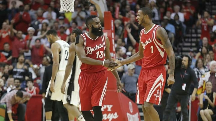 Dec 25, 2015; Houston, TX, USA; Houston Rockets guard James Harden (13) reacts to a three-point basket by forward Trevor Ariza (1) against the San Antonio Spurs in the second half of a NBA basketball game on Christmas at Toyota Center. Rockets won 88 to 84. Mandatory Credit: Thomas B. Shea-USA TODAY Sports