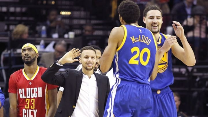 Dec 31, 2015; Houston, TX, USA; Golden State Warriors Stephan Curry high fives his teammates during a Houston Rockets timeout in the second half at Toyota Center. The Warriors won 114 to 110. Mandatory Credit: Thomas B. Shea-USA TODAY Sports