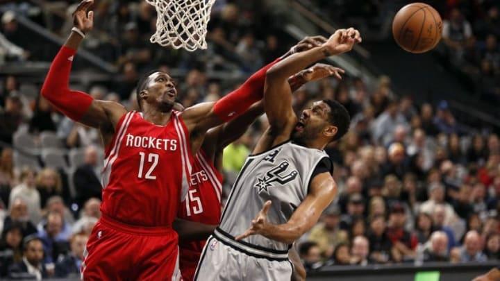Jan 2, 2016; San Antonio, TX, USA; San Antonio Spurs power forward Tim Duncan (21) has his shot blocked by Houston Rockets center Dwight Howard (12) during the first half at AT&T Center. Mandatory Credit: Soobum Im-USA TODAY Sports