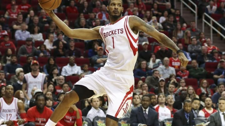 Jan 10, 2016; Houston, TX, USA; Houston Rockets forward Trevor Ariza (1) attempts to save a ball from going out of bounds during the third quarter against the Indiana Pacers at Toyota Center. The Rockets won 107-103 in overtime. Mandatory Credit: Troy Taormina-USA TODAY Sports