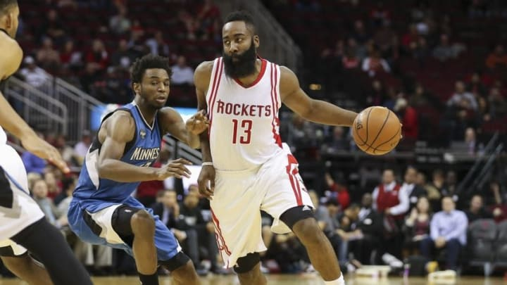 Jan 13, 2016; Houston, TX, USA; Houston Rockets guard James Harden (13) attempts to drive the ball around Minnesota Timberwolves guard Andrew Wiggins (22) during the first quarter at Toyota Center. Mandatory Credit: Troy Taormina-USA TODAY Sports