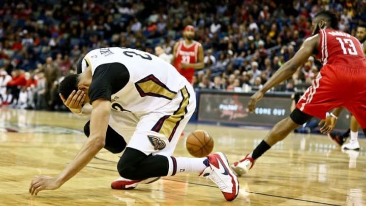 Jan 25, 2016; New Orleans, LA, USA; New Orleans Pelicans forward Anthony Davis (23) goes to the floor after taking an elbow to the head during the second quarter of a game against the Houston Rockets at the Smoothie King Center. Mandatory Credit: Derick E. Hingle-USA TODAY Sports