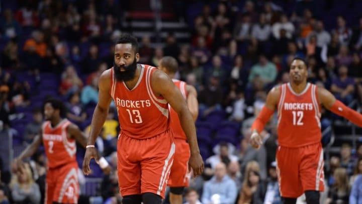 Feb 4, 2016; Phoenix, AZ, USA; Houston Rockets guard James Harden (13) defense in the game against the Phoenix Suns at Talking Stick Resort Arena. Mandatory Credit: Jennifer Stewart-USA TODAY Sports