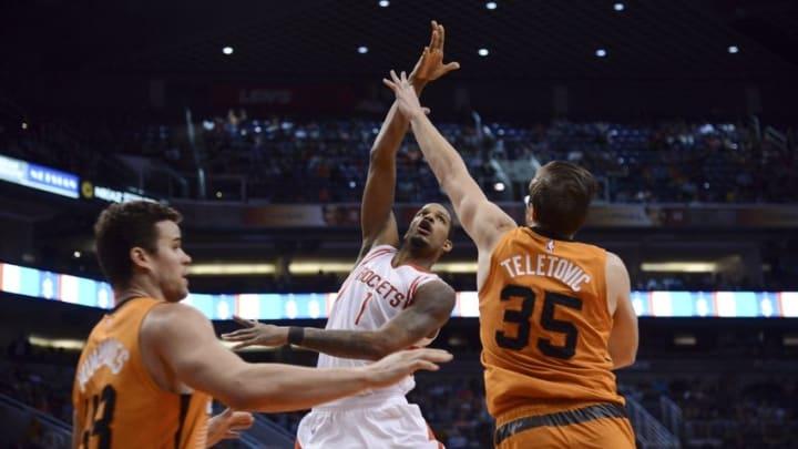 Feb 19, 2016; Phoenix, AZ, USA; Houston Rockets forward Trevor Ariza (1) passes the ball past Phoenix Suns forward Mirza Teletovic (35) during the second half at Talking Stick Resort Arena. The Rockets won 116-100. Mandatory Credit: Joe Camporeale-USA TODAY Sports