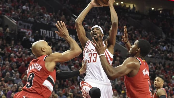 Feb 25, 2016; Portland, OR, USA; Houston Rockets guard Corey Brewer (33) drives to the basket on Portland Trail Blazers guard Gerald Henderson (9) and forward Maurice Harkless (4)during the first quarter of the game at the Moda Center at the Rose Quarter. Mandatory Credit: Steve Dykes-USA TODAY Sports
