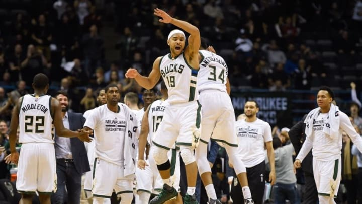 Feb 29, 2016; Milwaukee, WI, USA; Milwaukee Bucks guard Jerryd Bayless (19) celebrates with forward Giannis Antetokounmpo (34) after hitting a 3-point basket in the fourth quarter during the game against the Houston Rockets at BMO Harris Bradley Center. The Bucks beat the Rockets 128-121. Mandatory Credit: Benny Sieu-USA TODAY Sports
