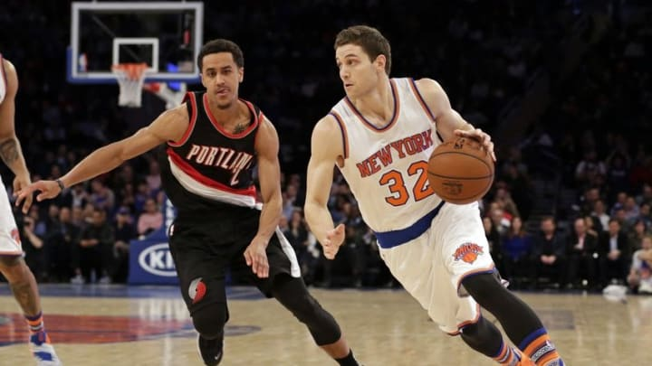 Mar 1, 2016; New York, NY, USA; New York Knicks guard Jimmer Fredette (32) drives to the basket past Portland Trail Blazers guard Brian Roberts (2) during the second half at Madison Square Garden. The Trail Blazers defeated the Knicks 104-85. Mandatory Credit: Adam Hunger-USA TODAY Sports