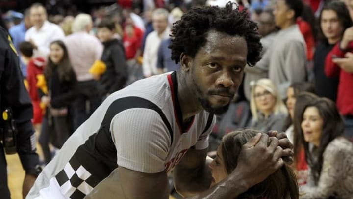 Mar 2, 2016; Houston, TX, USA; Houston Rockets guard Patrick Beverley (2) hugs a fan after defeating the New Orleans Pelicans at Toyota Center. The Rockets won 100-95. Mandatory Credit: Thomas B. Shea-USA TODAY Sports