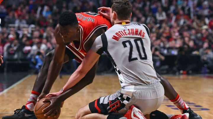 Mar 5, 2016; Chicago, IL, USA; Chicago Bulls forward Bobby Portis (5) and Houston Rockets forward Donatas Motiejunas (20) attempt to get a loose ball during the second quarter at the United Center. Mandatory Credit: Mike DiNovo-USA TODAY Sports
