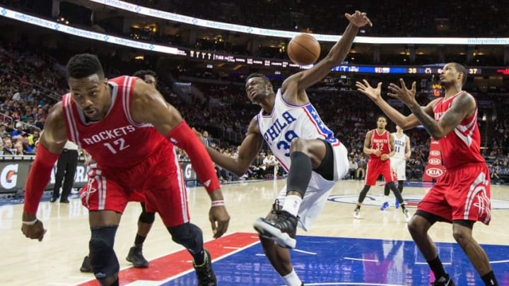 Mar 9, 2016; Philadelphia, PA, USA; Houston Rockets center Dwight Howard (12) knocks the ball away from Philadelphia 76ers forward Jerami Grant (39) as he drives to the basket during the first half at Wells Fargo Center. The Houston Rockets won 118-104. Mandatory Credit: Bill Streicher-USA TODAY Sports