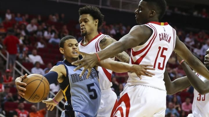 Mar 14, 2016; Houston, TX, USA; Memphis Grizzlies guard Ray McCallum (5) is fouled by Houston Rockets guard K.J. McDaniels (32) during the fourth quarter at Toyota Center. Mandatory Credit: Troy Taormina-USA TODAY Sports